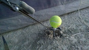 Rebar, washer, and hose clamp. The tennis ball saves your feet.
